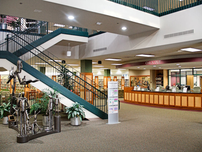 Entrance to the library near the circulation desk and stairs